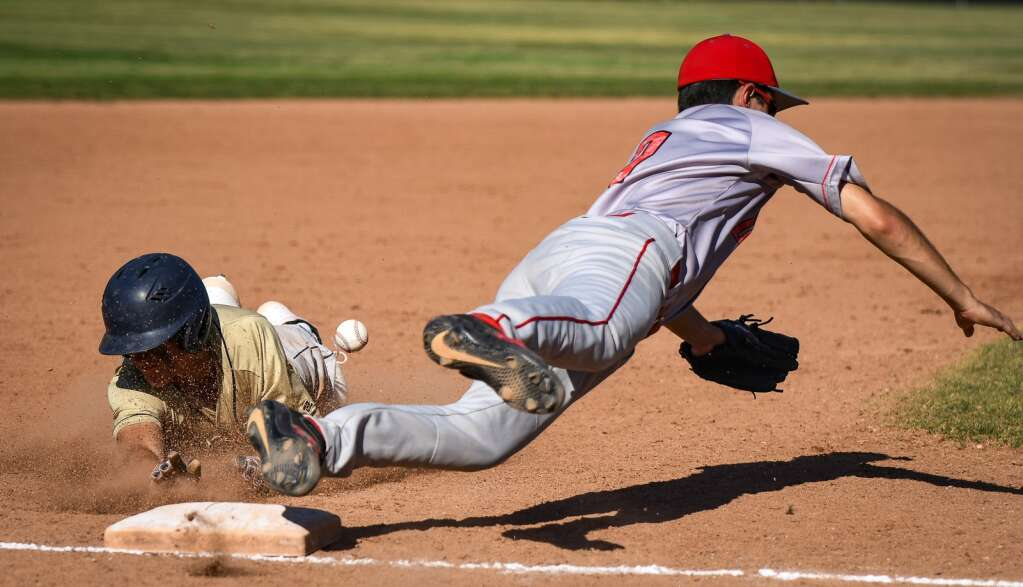 A Rifle Bear steals third base during Monday's game against the Glenwood Springs Demons. |Chelsea Self / Post Independent