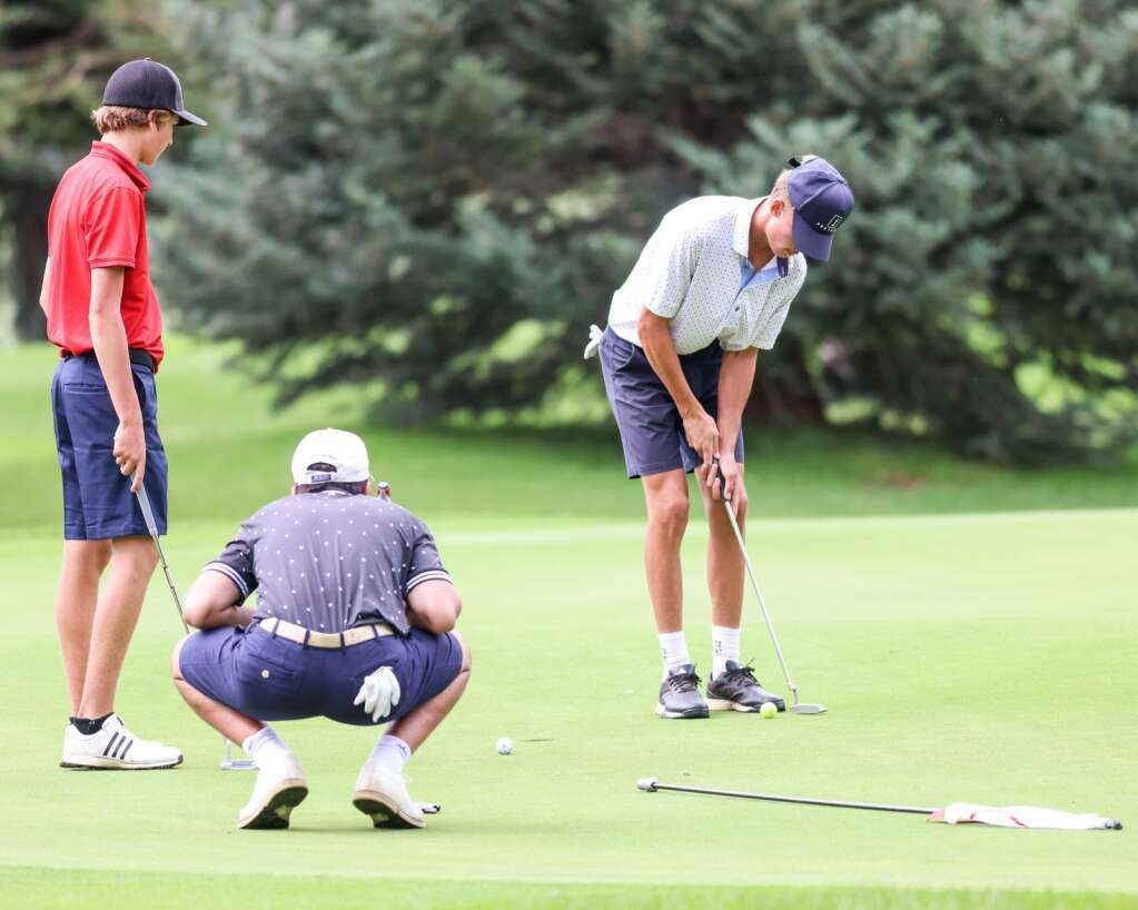 Aspen High School's Sky Sosna, right, putts during practice on Tuesday, Aug. 3, 2021, at Aspen Golf Club. Photo by Austin Colbert/The Aspen Times.