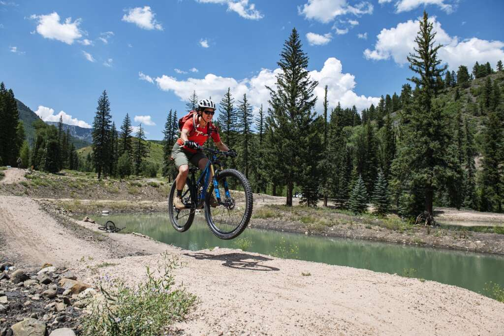 Trina Ortega takes a jump line around one of the ponds on the Coal Basin Ranch property near Redstone on Thursday, July 29, 2021. (Kelsey Brunner/The Aspen Times)