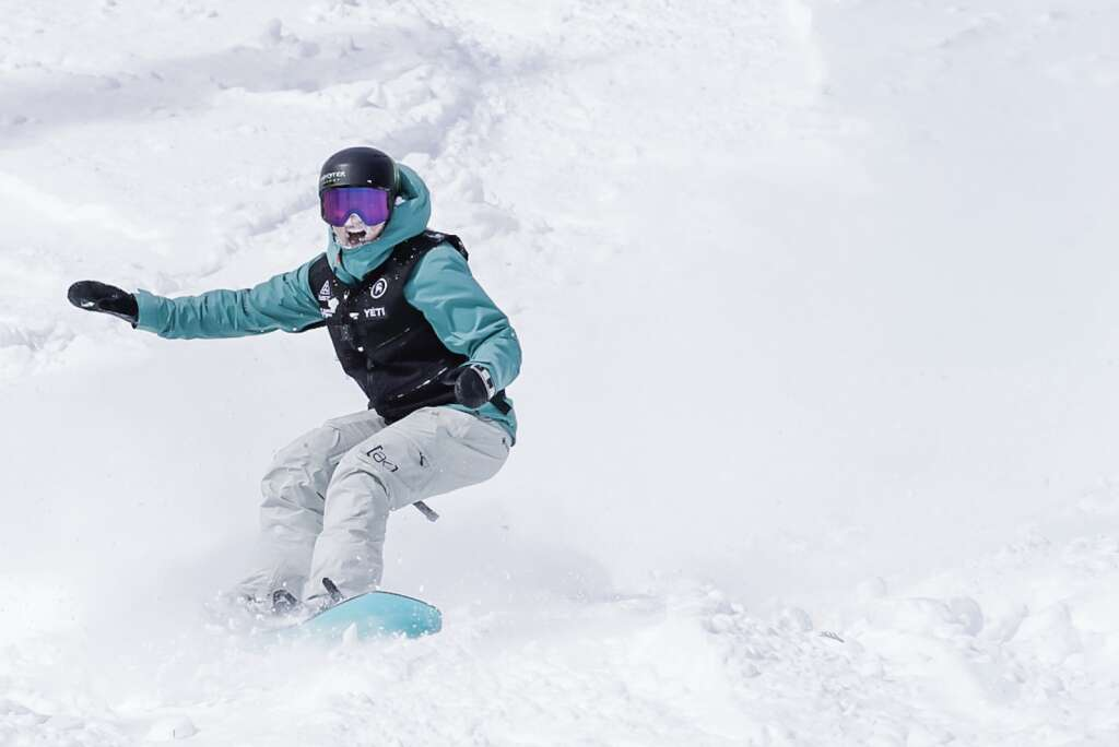 Women's champion Zoi Sadowski-Synnott of New Zealand rides out a landing during Tuesday's final round of the Natural Selection Tour at Jackson Hole Mountain Resort in Jackson, Wyoming. | Photo by Leslie Hittmeier / Red Bull