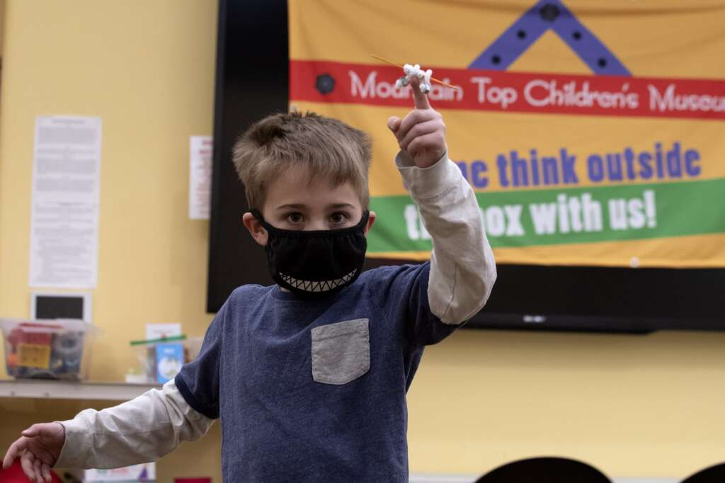 Quinn Dumit works on balancing an object on his finger while attending the Mountain Top Exploratorium after-school program at the Summit County Library south branch in Breckenridge on Monday, Jan. 25.   Photo by Jason Connolly / Jason Connolly Photography