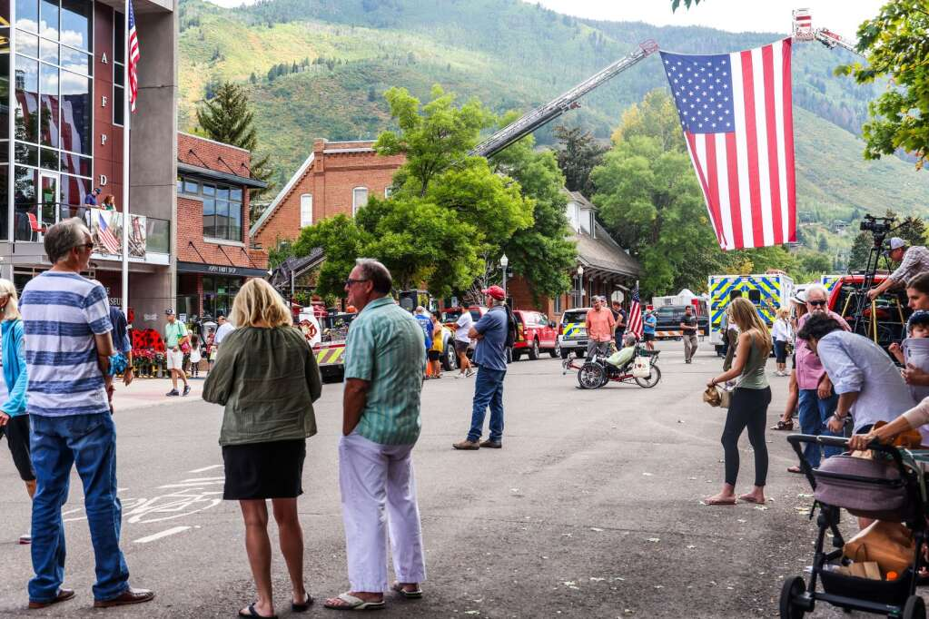 People gather in front of the Aspen Fire Protection District building in downtown Aspen to commemorate the September 11, 2001 terrorist attacks in New York City on Saturday, September 11, 2021.  Photo by Austin Colbert / The Aspen Times.