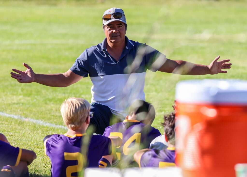 Basalt High School boys soccer coach Carlos Salazar talks to the players during halftime of their game against Aspen on Wednesday, Sept. 15, 2021, on the BHS field. | Photo by Austin Colbert/The Aspen Times