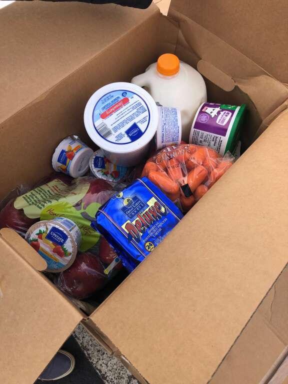Food boxes provided by Food Bank of the Rockies included apples and carrots on Tuesday. | Scott Condon/The Aspen Times