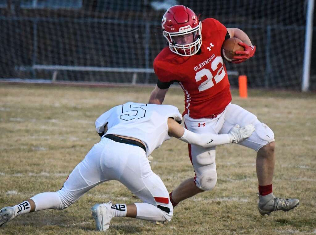 Glenwood Springs Demon Garrett Dollahan gets pushed out of bounds during Friday night's season opener against the Aspen Skiers. |Chelsea Self / Post Independent