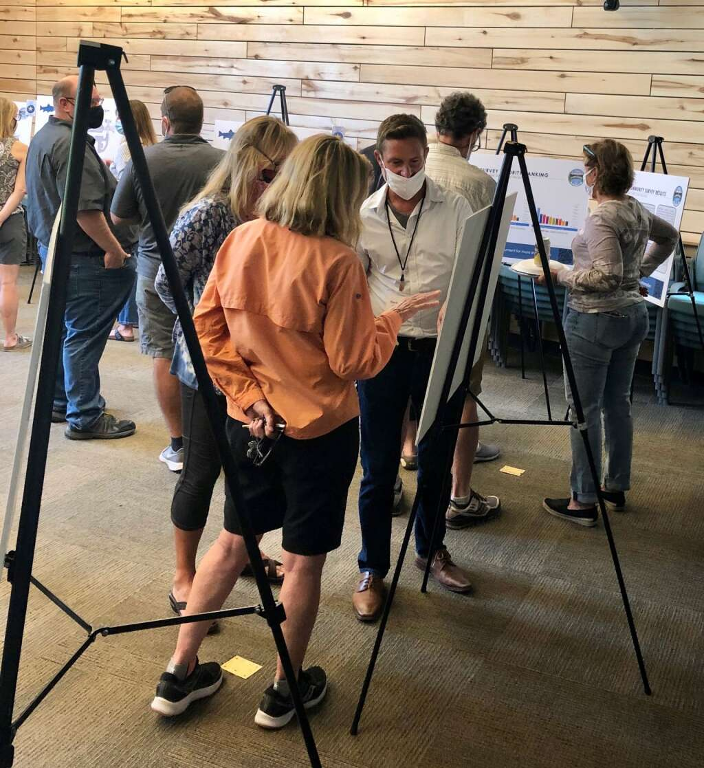 Members of the public check out information boards at provide information about top proposed projects in Basalt at an open house on Aug. 4. | Scott Condon/The Aspen Times