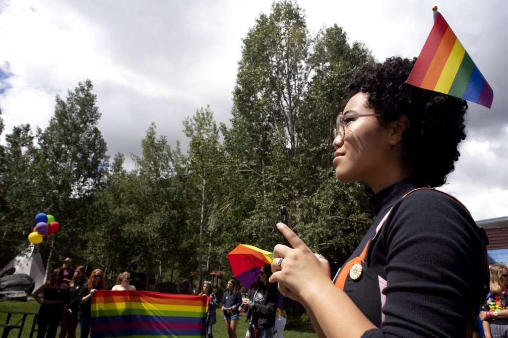 Isabella Jones of Colorado Springs listens to speakers at the Frisco Historic Park & Museum after marching down Main Street during the Pride March in Frisco on Sunday, June 27. | Photo by Jason Connolly/ Jason Connolly Photography