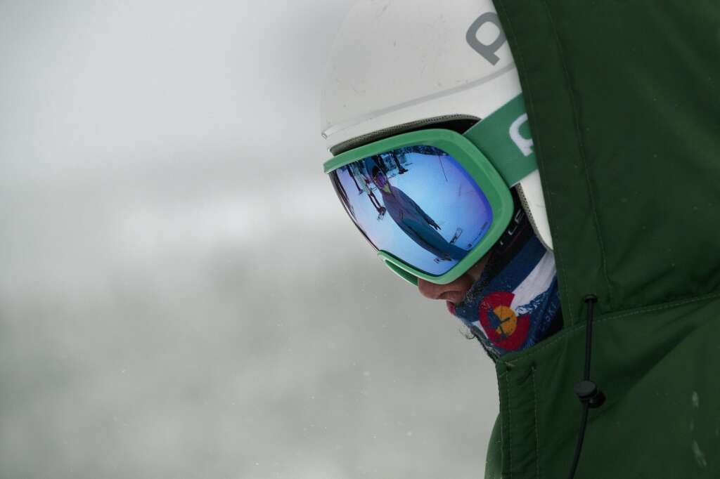 Summit High School Alpine ski team coach Karl Barth is reflected in skier Gavin Master's goggles during a ski competition at Keystone Resort on Friday, Feb. 5, 2021. | Photo by Jason Connolly / Jason Connolly Photography