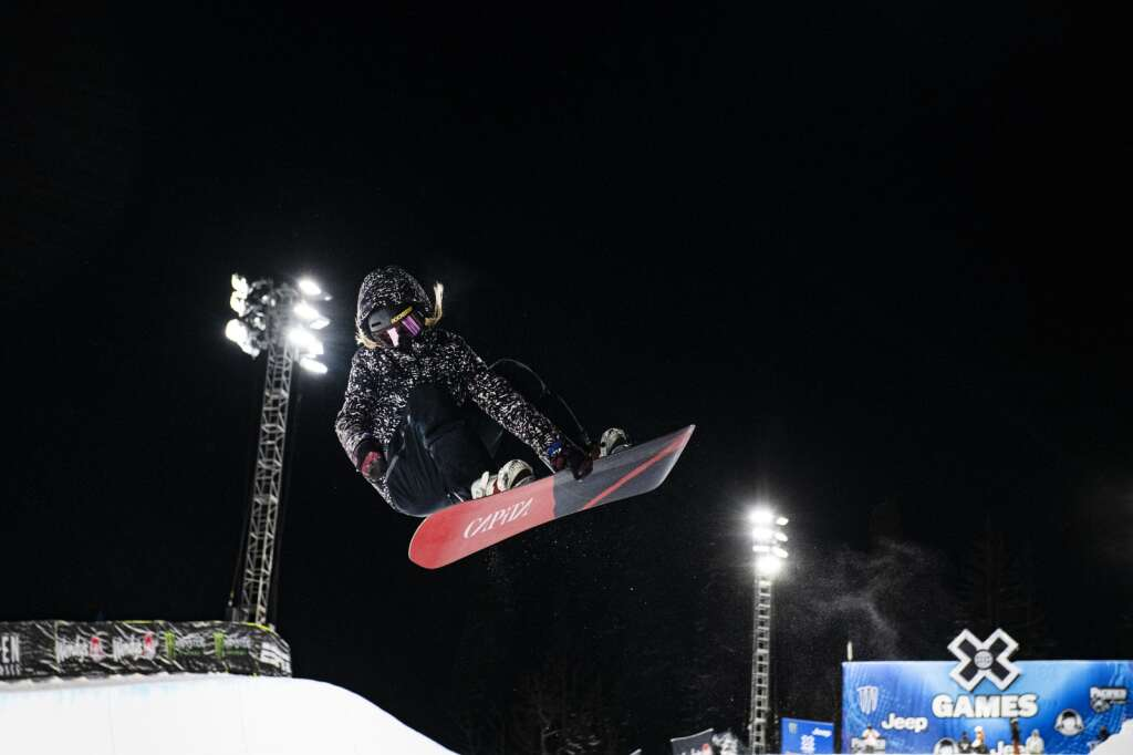 American snowboarder Chloe Kim airs out of the Buttermilk Superpipe on the first evening of practice for the 2021 X Games Aspen on Tuesday, Jan. 26, 2021.