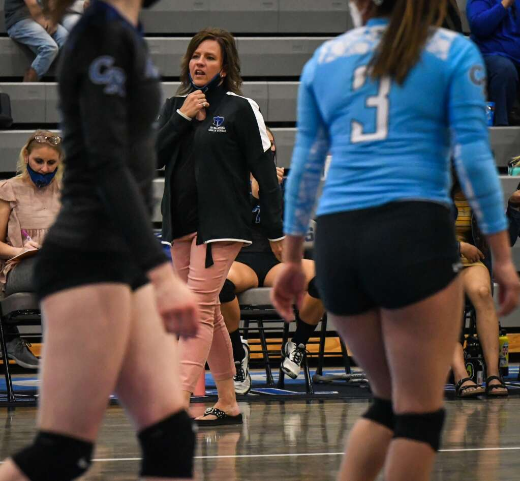 Coal Ridge Volleyball Coach Aimee Gerber speaks to her players during last week's game against Rifle. |Chelsea Self / Post Independent