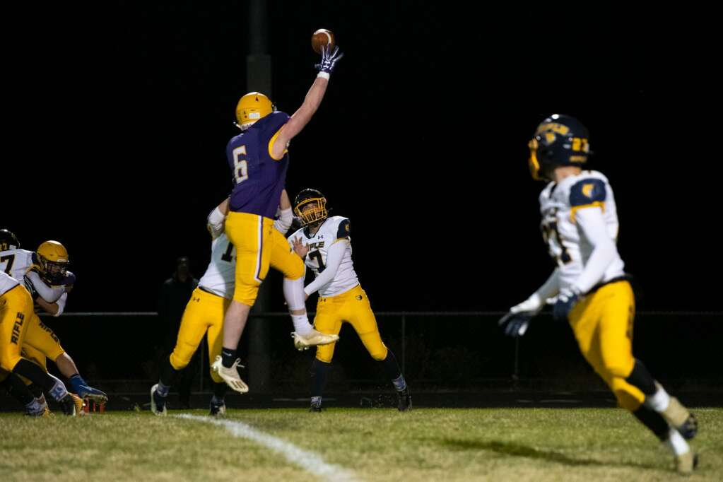 Basalt's Cooper Crawford (6) jumps to intercept a pass by Rifle on Friday, Oct. 22, 2021. | Kelsey Brunner/The Aspen Times