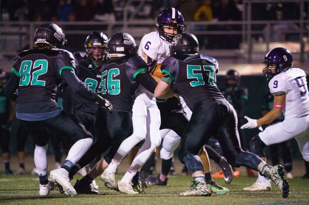 The Summit Tigers defense swarms a Middle Park ball carrier in the fourth quarter of the Tigers' homecoming win against the Middle Park Panthers on Friday, Sept. 24, at Tiger Stadium in Breckenridge. | John Hanson/For the Summit Daily News