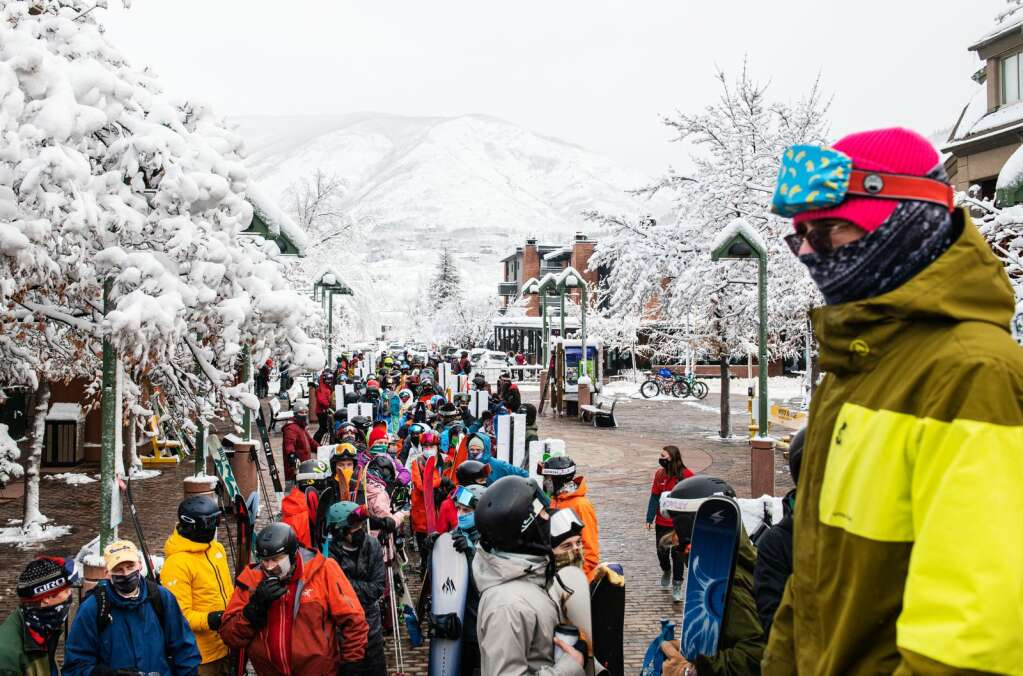 Skiers line up around the block to load the Silver Queen Gondola to ski Aspen Mountain after a fresh 14 inch snowfall on Thursday, Feb. 4, 2021. (Kelsey Brunner/The Aspen Times)