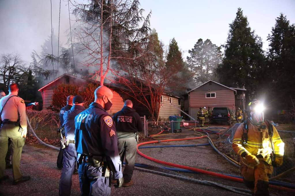 Smoke fills the air surrounding the Parkview Drive neighborhood in Grass Valley Friday evening where a structure fire involving victims occurred.