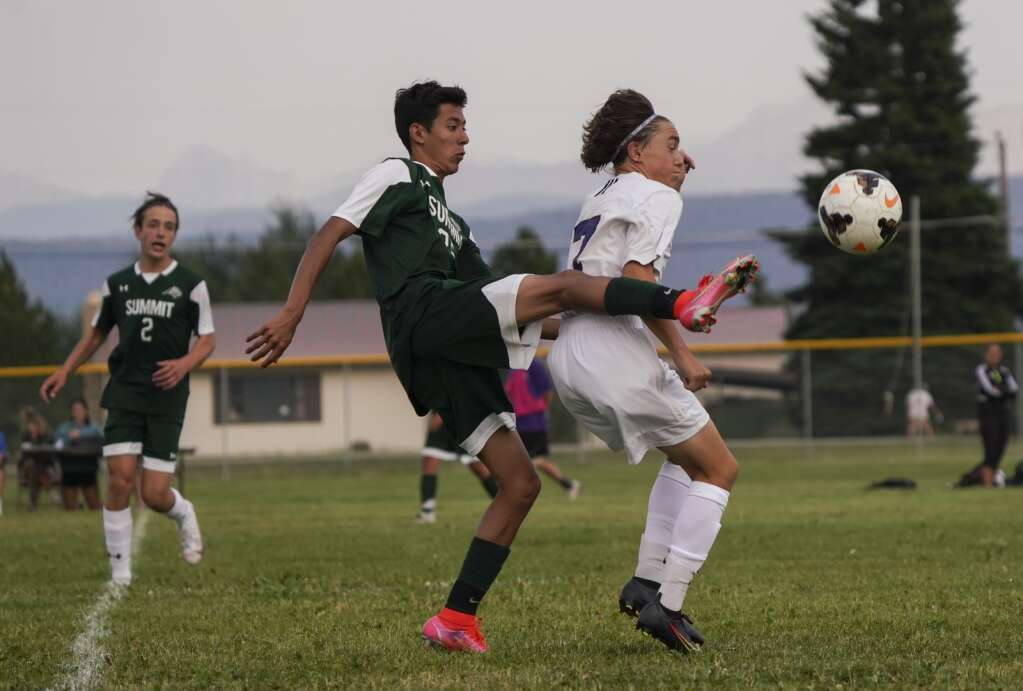 Irvin Ortega (center) contends with a Middle Park defender for possession during the Summit High School varsity boys soccer team's scrimmage vs. Middle Park High School on Tuesday at Middle Park. | Photo by Eli Pace / Sky-Hi News