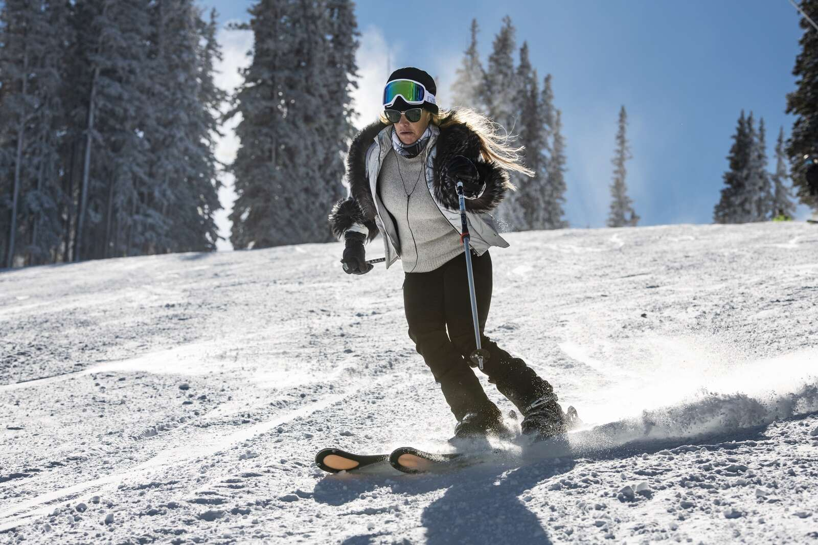 A skier carves in fresh snow on opening day of Aspen Mountain on Wednesday, Nov. 25, 2020. (Kelsey Brunner/The Aspen Times)