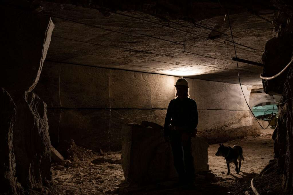 Robert Congdon stands inside of his White Banks Alabaster Mine with his faithful companion outside of Redstone on Thursday, July 29, 2021. (Kelsey Brunner/The Aspen Times)