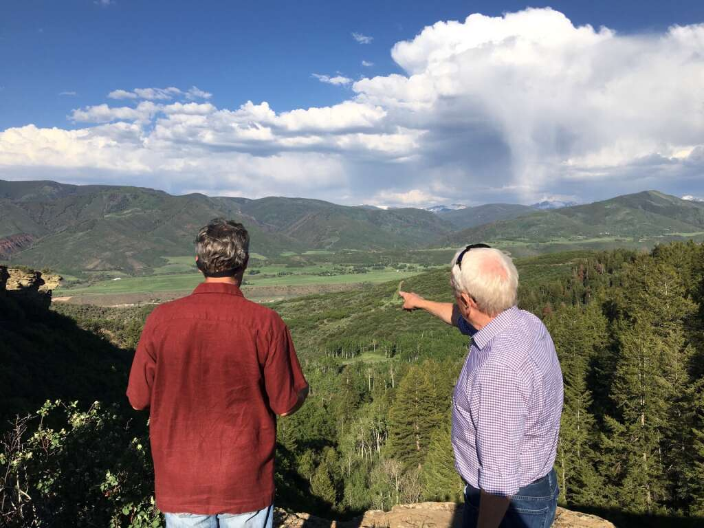 Snowmass Village Mayor Bill Madsen (left) takes in the view over Cougar Canyon with attorney David Myler during a site visit on Monday, June 7, 2021.   Kaya Williams/The Snowmass Sun