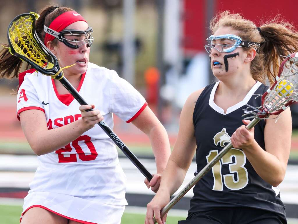 Aspen High School girls lacrosse player Isla Smagala defends against Battle Mountain on Wednesday, May 12, 2021, on the AHS turf. The Skiers won, 8-6. Photo by Austin Colbert/The Aspen Times.
