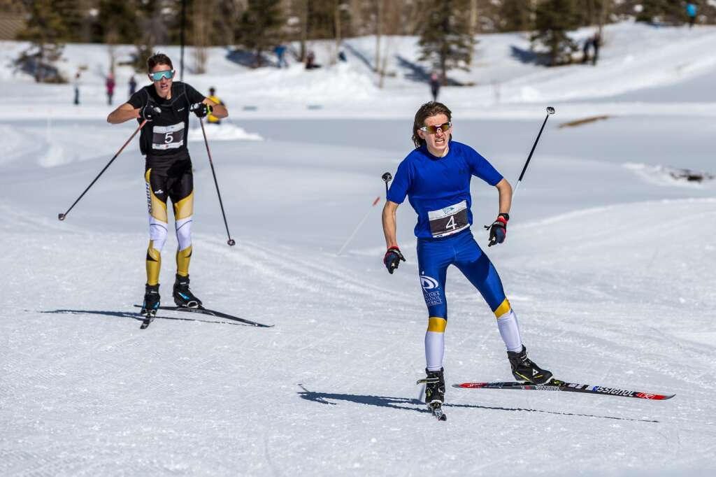 Sullivan Middaugh, 5, and Campbell Forkner, 4, skate to the finish line in the boys 3K race at the 2021 Colorado Nordic Ski State Championships held at the Gold Run Nordic Center in Breckenridge on Saturday, March 6. | Photo by Liz Copan / Studio Copan