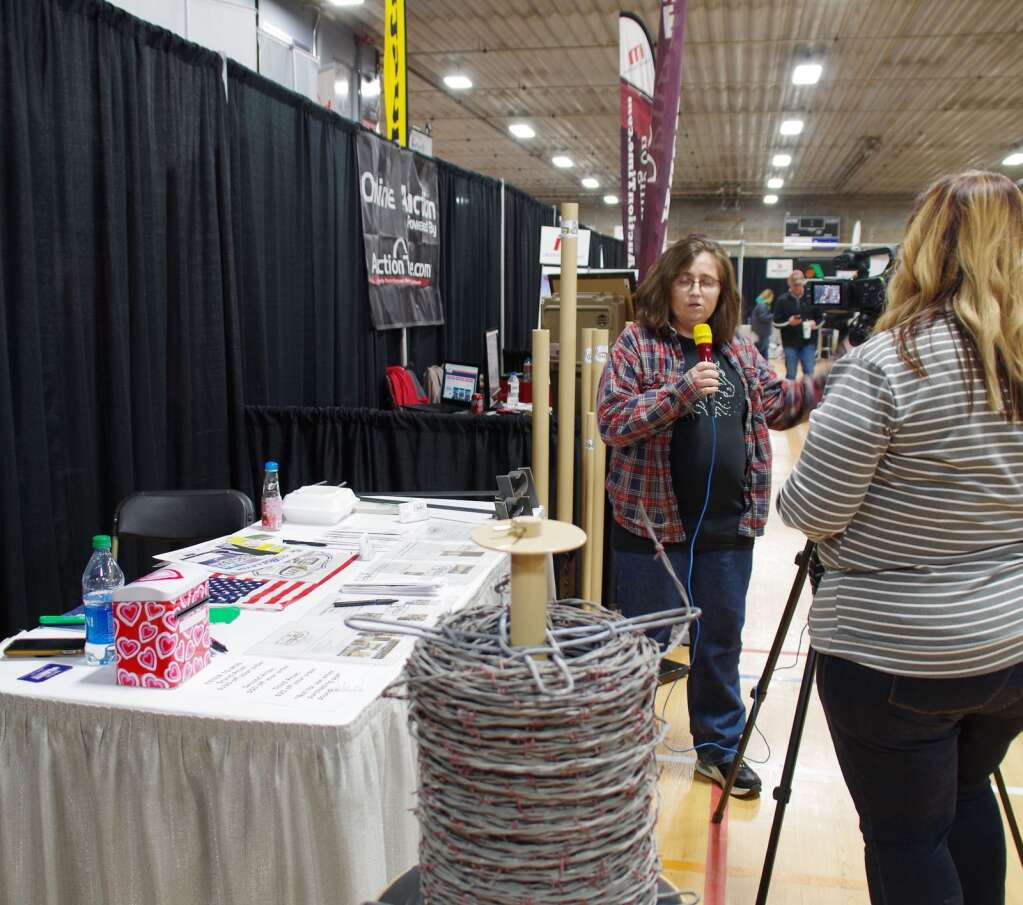 Susan Littlefield, back to camera, interviews Laura Honeywell for one of her remote segments aired on KRVN from the Expo.