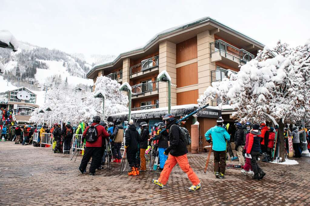 Skiers line up around the block to load the Silver Queen Gondola to ski Aspen Mountain after a fresh 14-inch snowfall on Thursday, Feb. 4, 2021. (Kelsey Brunner/The Aspen Times)
