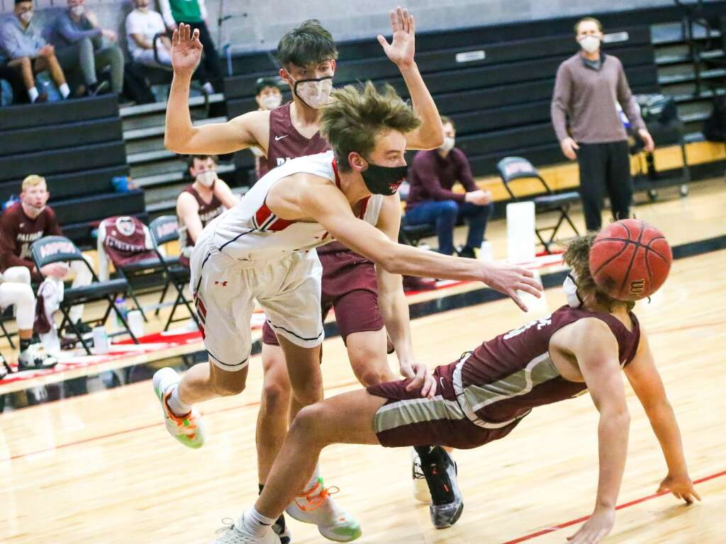 Aspen High School's Braden Korpela collides with a Palisade defender during Thursday's basketball game inside the AHS gymnasium. Photo by Austin Colbert/The Aspen Times.