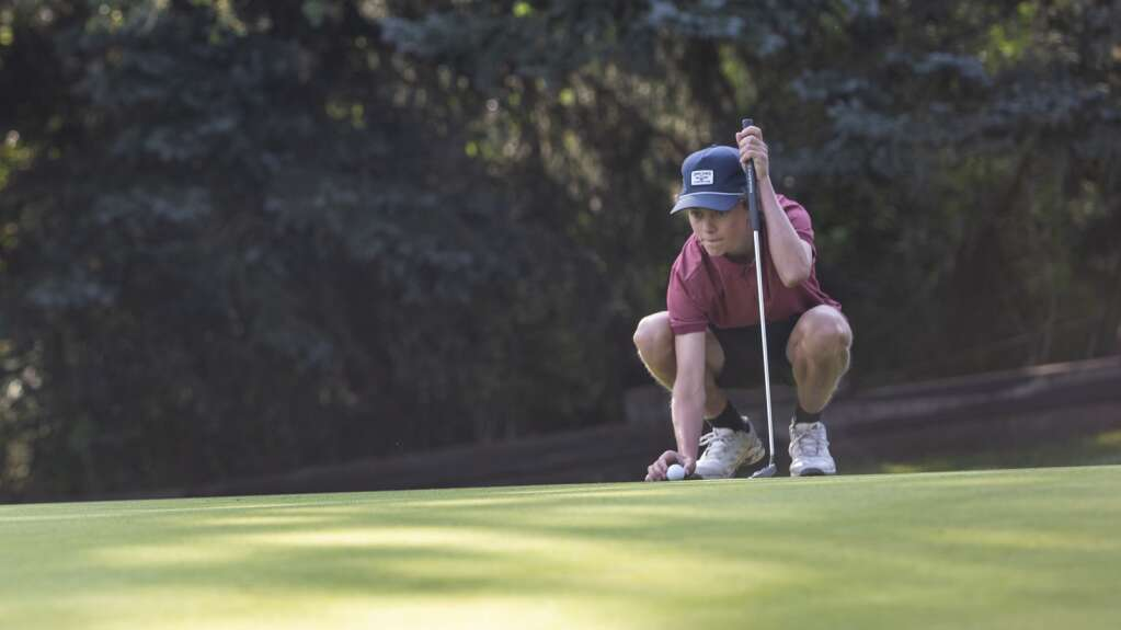Park City High School senior Will Agnew resets his ball on the green of hole four at the Park City Golf Club during the Miners' tournament Thursday morning, Sept. 9, 2021. (Tanzi Propst/Park Record)