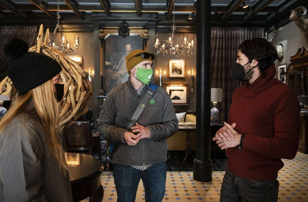 City of Aspen consumer health protection specialists Emmy Garrigus, left, and Mike Sear talks with Hotel Jerome general manager David Arraya about the new upcoming policies with the Red level restrictions in Aspen on Friday, Jan. 15, 2021. (Kelsey Brunner/The Aspen Times)