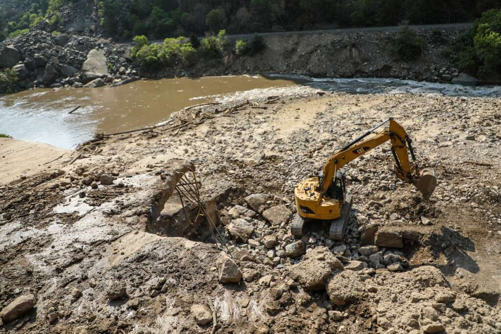An excavator works to fill a hole in Interstate 70 Wednesday after a series of mud and rock slides decimated the interstate at the end of July in Glenwood Canyon.   Chris Dillmann/cdillmann@vaildaily.com