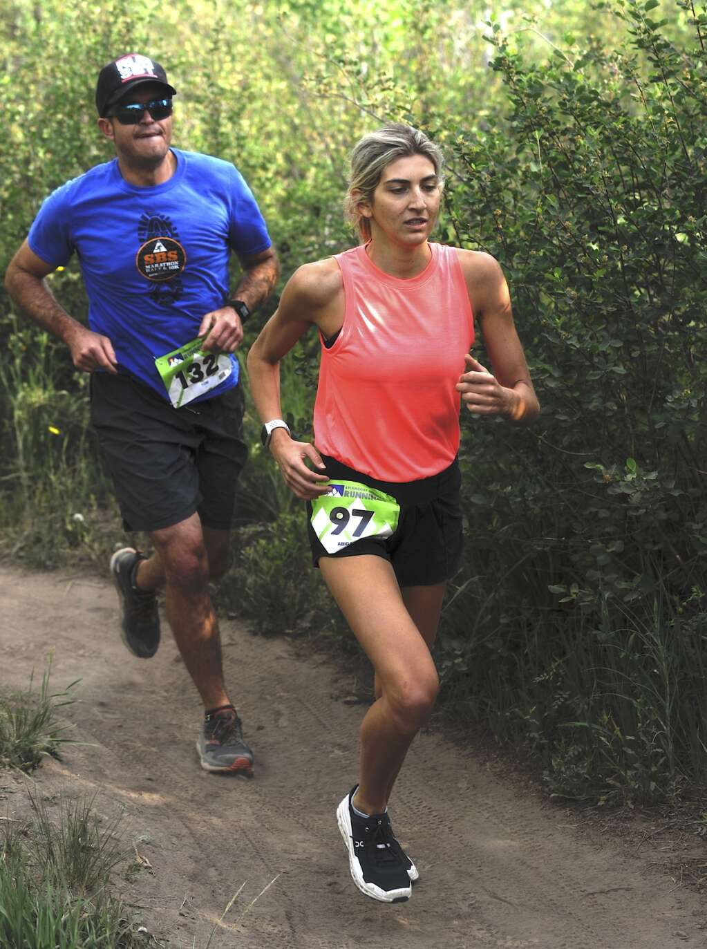 Tom Krabacher and Abigail Cosenza compete in the Steamboat Springs Running Series Howelsen Hill Trail Run on Saturday morning. (Photo by Shelby Reardon)