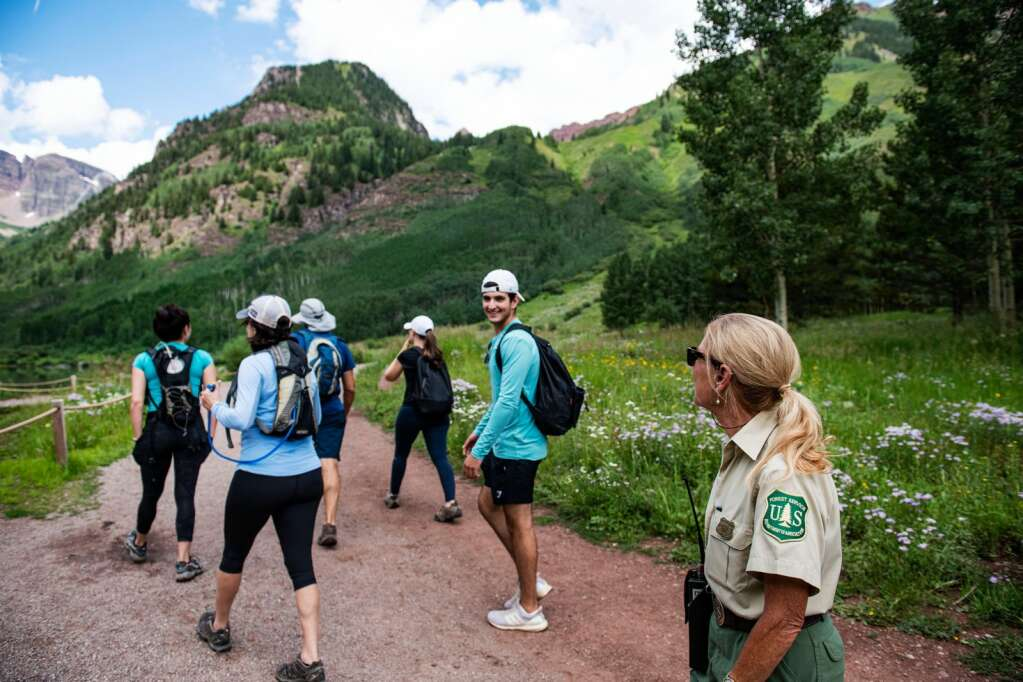 Peggy Jo Trish helps visitors at Maroon Lake on Thursday, July 22, 2021. (Kelsey Brunner/The Aspen Times)