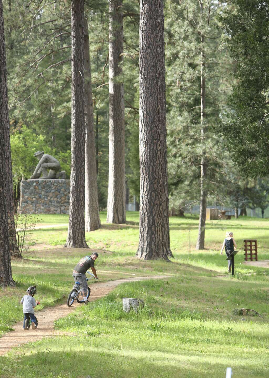 A family takes a stroll through Condon Park April 27 when the park officially re-opened after initial Covid-19 closures. | Photo: Elias Funez