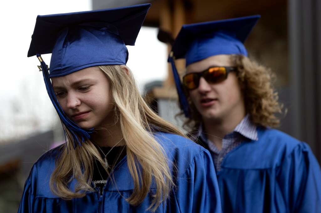 Seniors Saxan Netzel, left, and Jennings Heflin walk onto the stage during Snowy Peaks High School graduation Wednesday, May 26, at the Silverthorne Performing Arts Center in Silverthorne.   Photo by Jason Connolly / Jason Connolly Photography