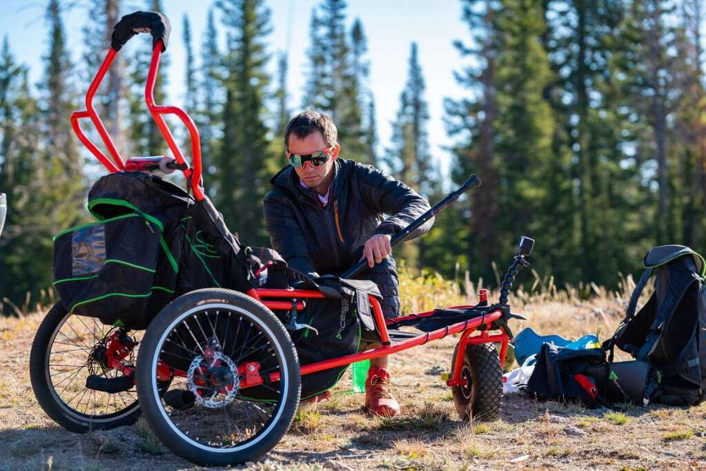 Charlie Martin prepares the Project Airtime adaptive wheelchair before a flight Sept. 25 from Williams Peak with passenger Teri Walker. | David Cudd/Courtesy photo
