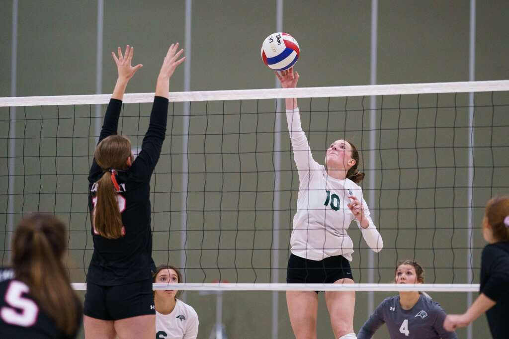 Summit High School's Ella Snyder taps the ball back to the Devils' side of the net during the third set of the Tigers' home conference match against the Eagle Valley Devils on Monday, Sept. 20, at Summit High School in Breckenridge. | John Hanson/For the Summit Daily News