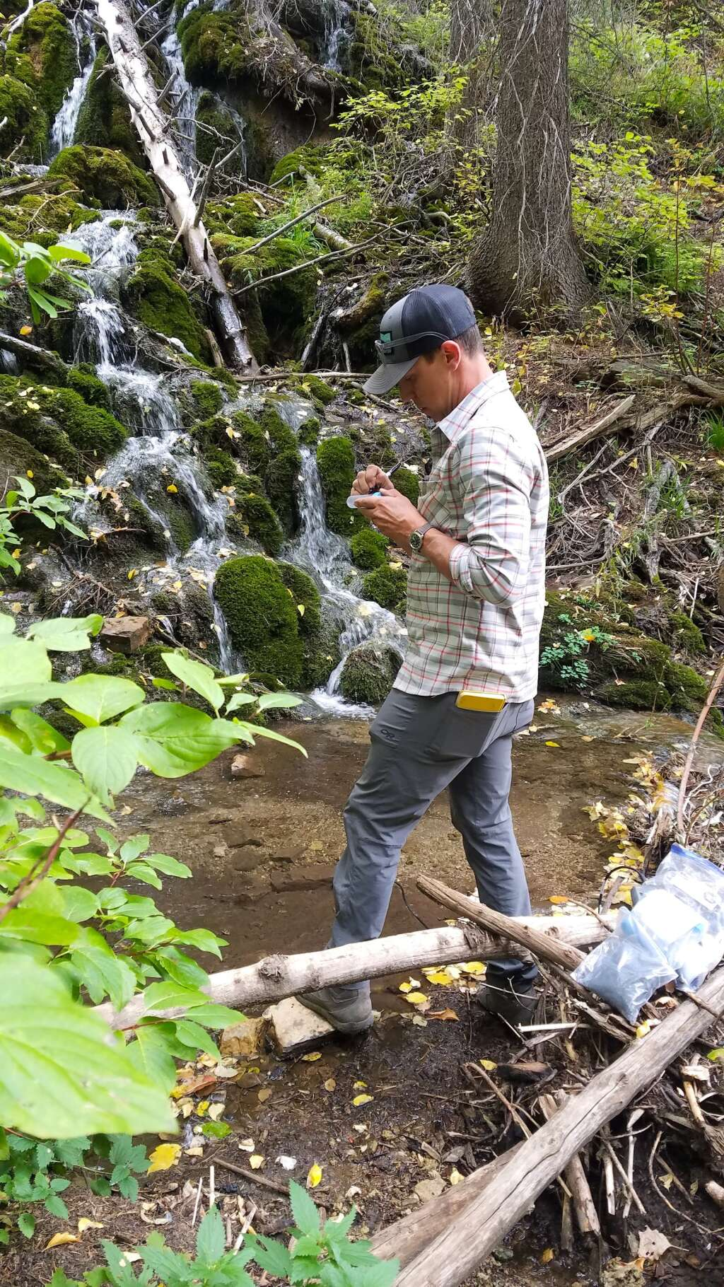 Ozark Underground Laboratory Senior Project Scientist Dave Woods installs small charcoal samplers in Dead Horse Creek. Tracers placed in the water upstream will accumulate on the charcoal, allowing the specific upstream water sources to be documented. | White River National Forest/Courtesy photo
