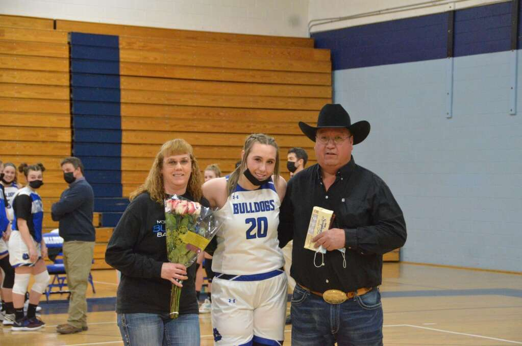 Senior Amber Salazar stands with her parents during the Senior Night celebration at Moffat County High School Thursday. (Max O'Neill / Craig Press)