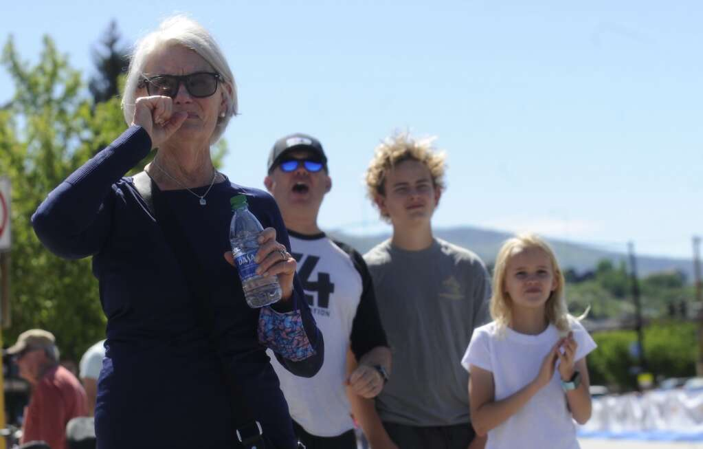 Alix Van Sickle's family cheers her on as she approaches the final stretch of the Steamboat Marathon on Sunday morning. Van Sickle's husband, Mike, and children Lily and Jacob Block yell and clap as Van Sickle's mom tears up. (Shelby Reardon)