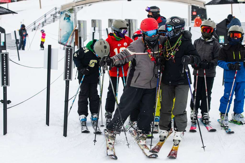 Festive skiers wait in line at the Village Express on Mardi Gras in Snowmass on Tuesday, Feb. 16, 2021. (Kelsey Brunner/The Aspen Times)