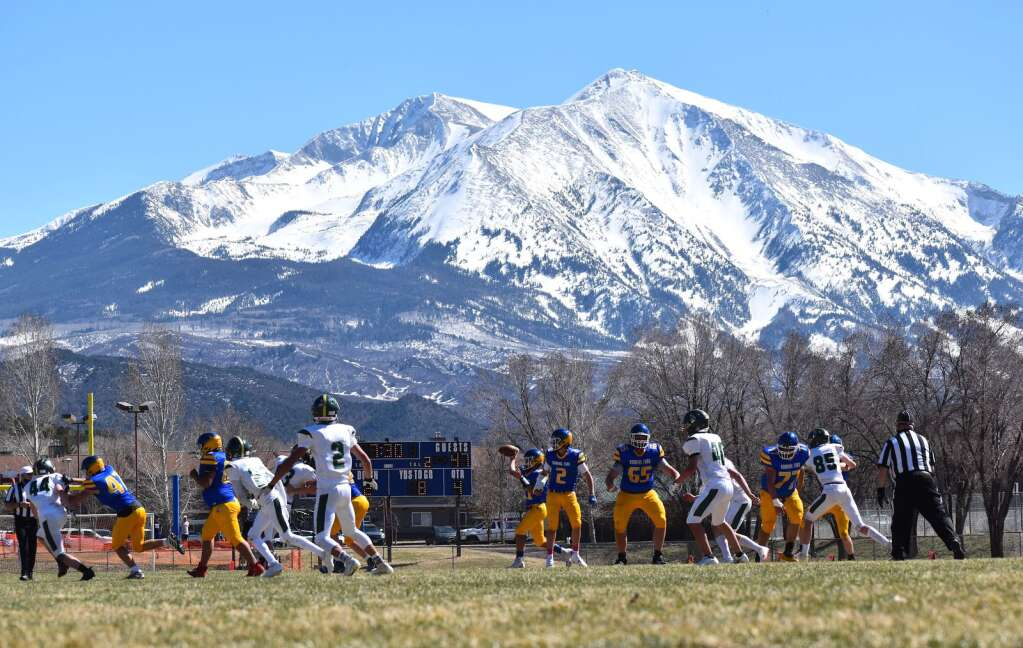 Mt. Sopris was the usual picture-perfect backdrop to the Roaring Fork-Manitou Springs high school football game Saturday in Carbondale.