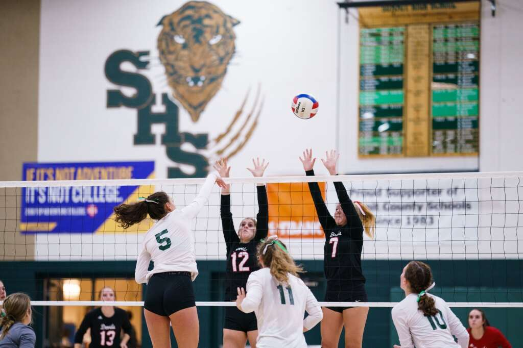 Summit junior Autumn Rivera spikes the ball past the Devils' defense during the Tigers' 25-9 third set loss in the home conference match against the Eagle Valley Devils on Monday, Sept. 20, at Summit High School in Breckenridge. | John Hanson/For the Summit Daily News