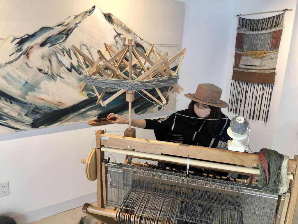 Straight Line Studio artist-in-residence Nina Pivirotto works at her loom in Snowmass Base Village on March 15, 2021. | Kaya Williams/The Snowmass Sun