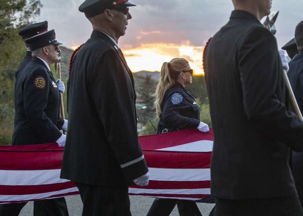 The Park City Fire District Honor Guard carries the American flag down S.R. 224 Saturday morning as part of a procession marking the 20th anniversary of the Sept. 11 terrorist attacks. (Tanzi Propst/Park Record)