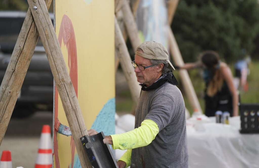 Muralist Tom Ward of Denver works on his piece for the Fraser Mountain Mural Festival on Friday. Aug. 6, 2021. Ward is one of 25 artists vying for cash prizes and recognition in this year's festival. | Eli Pace / epace@skyhinews.com