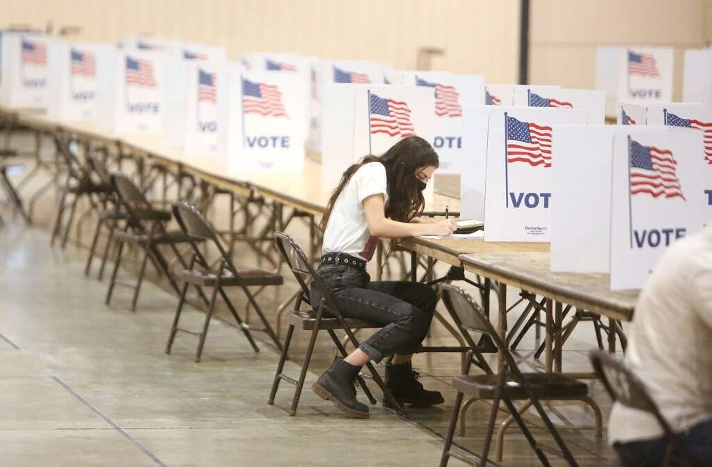 First time voter, Grass Valley's Kiave Codianne, works on filling out her ballot  Nov. 1 at the vote center set up at the Nevada County Fairgrounds. | Photo: Elias Funez
