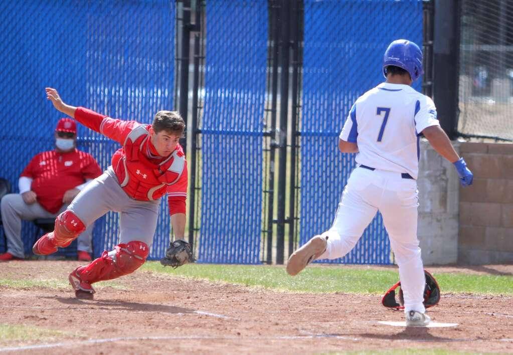 Joel Gomez scores before Wooster's catcher could make a play.