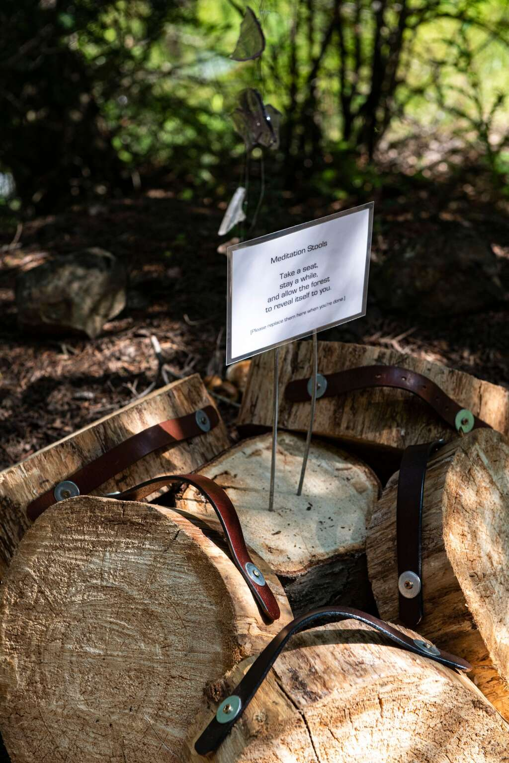 """Meditation stools are piled for use in the """"Earthly Palace Forest Shrine"""" created by local artist Lara Whitley for the """"Aspen Space Station"""" on the backside of Aspen Mountain.  (Kelsey Brunner/The Aspen Times)"""