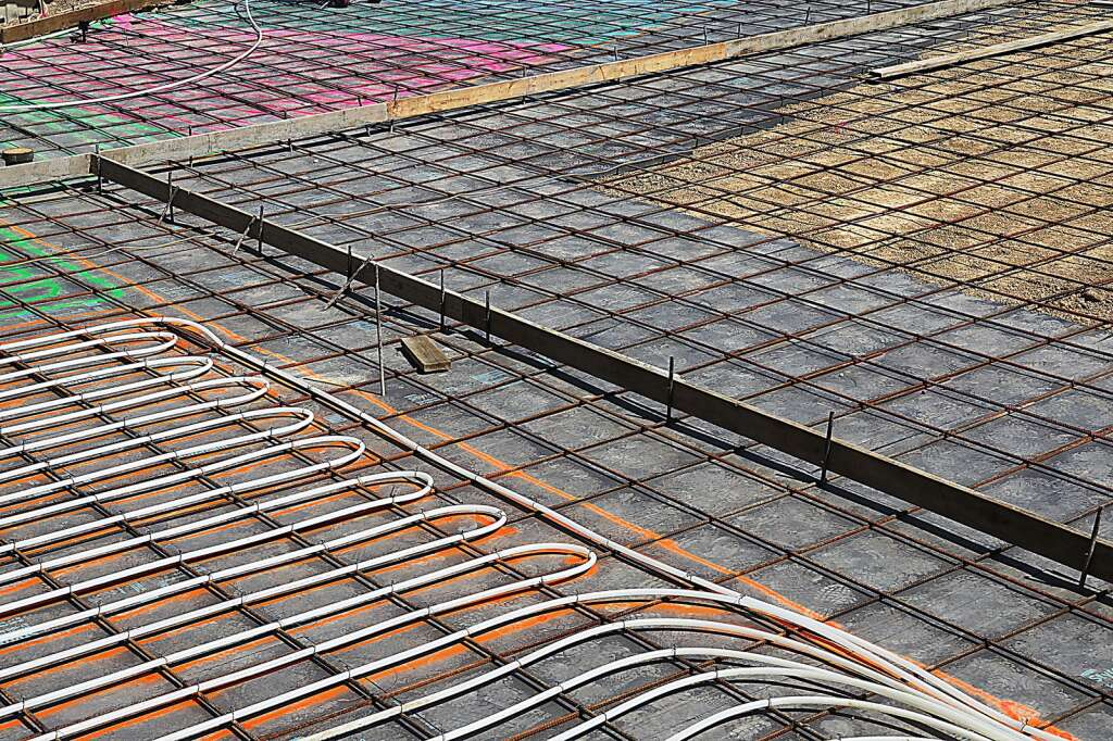 The snow-melt system and rebar make a rainbow of colors as crews prepare to pour concrete and finish off the loading dock area at the new Sleeping Giant School. (Photo by John F. Russell)