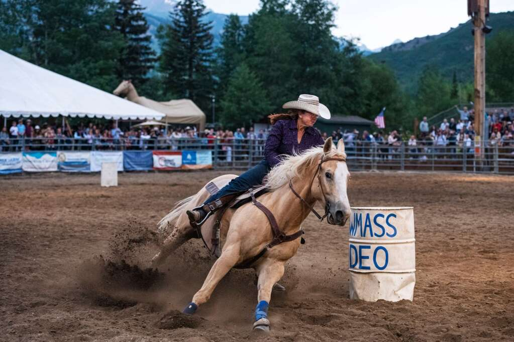 A barrel racer makes a turn at the Snowmass Rodeo on Wednesday, June 23, 2021. (Kelsey Brunner/The Aspen Times)